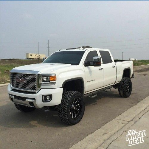 "22x10"" KMC XD Bomb Black wheels with 325-50-22 Nitto Trail Grappler tires on a 2015 GMC Denali 2500"