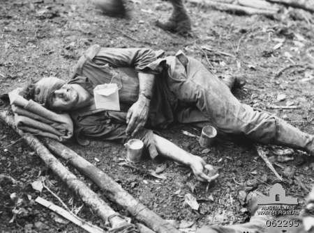Corporal Mervyn Hall lies wounded after he single handedly attacked and wiped out a Japanese pillbox at the Battle of Shaggy Ridge.