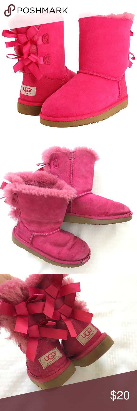 UGGS BAILEY BOW PINK LACE UP GIRLS BOOTS Such cute little girls winter shoes! Obviously in play condition but still lots of life left in them. Size 11. Check out my other kids items and feel free to ask any questions! Offers always welcome! UGG Shoes Boots