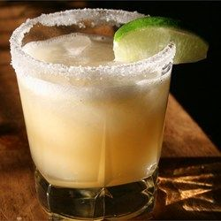 Beer Margaritas   makes 6 (1 cup)   1 (12 oz) can frozen limeade concentrate  12 oz tequila  12 oz water  12 oz beer  ice  1 lime, cut into wedges Pour limeade, tequila, water, & beer into a lg pitcher. Stir til well-blended, & limeade has melted. Add plenty of ice, & garnish w/ lime wedges. Adjust w/ additional water, if needed.