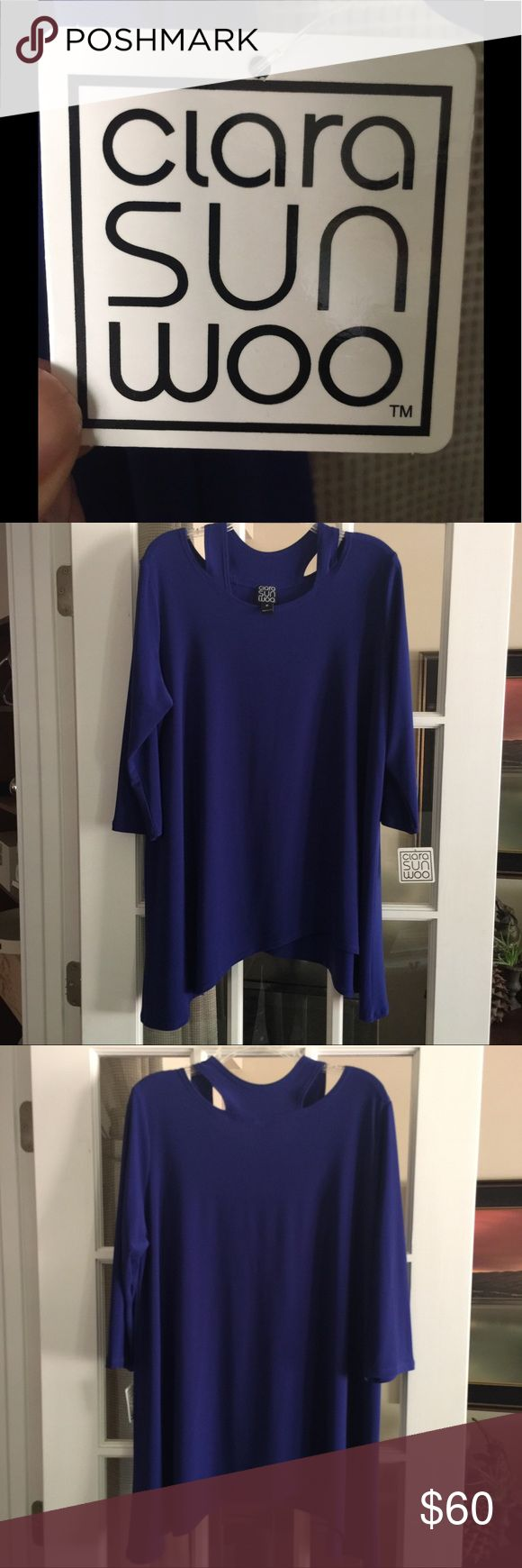 Gorgeous cobalt coverage! Wear this Clara Sunwoo top over a pencil skirt or leggings. Narrow cut-out on shoulders shows just a sliver of skin. Bra straps are completely covered. Shark bite hem. My favorite color. NWT. Clara Sunwoo Tops Tunics