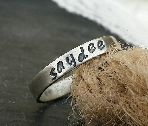 Check out this item in my Etsy shop https://www.etsy.com/ca/listing/469571306/name-stacking-rings-name-rings