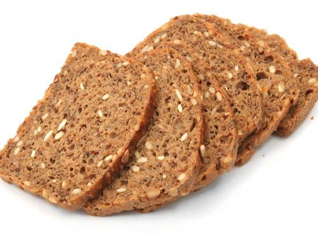 A recipe for 12 Grain Bread made with water, butter, honey, salt, 12 grain flour, whole wheat flour, bread machine
