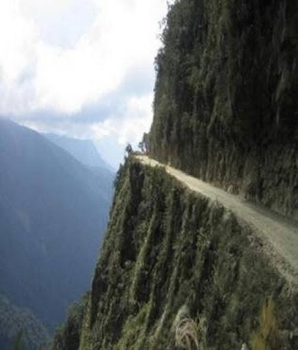 World's Most dangerous road! The North Yungas Road (alternatively El Camino de la Muerte, Road of Death or Death Road). The road connects the Bolivian capital of La Paz with the low-lying region of Yungas in the Amazonian rainforest. In order to do so, the road must traverse the mighty Cordillera Oriental mountain chain. By some estimates, between 200 and 300 people die a year on this road.