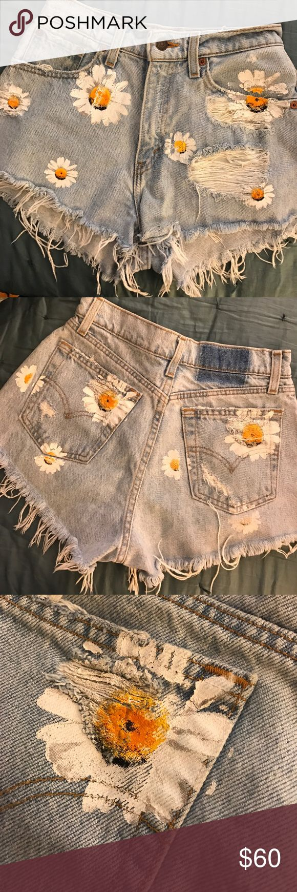 Hand Painted Daisy Levi Shorts Purchased these from LF a few years back and have only worn once! They are a first of a kind brand meaning that they are 100% unique! I'm a size 27 and they are just a little too snug for me now! Levi's Shorts Jean Shorts
