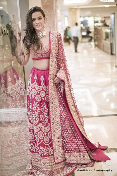 dark pink lehenga, gold work, gold sequins blouse, zari work, gold border, pink net dupatta, gold motifs on dupatta