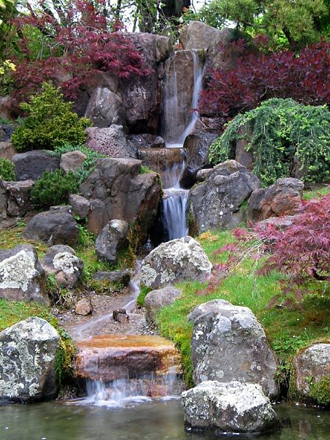 Yard Landscaping With Natural Waterfall, Plants And Landscaping Rocks