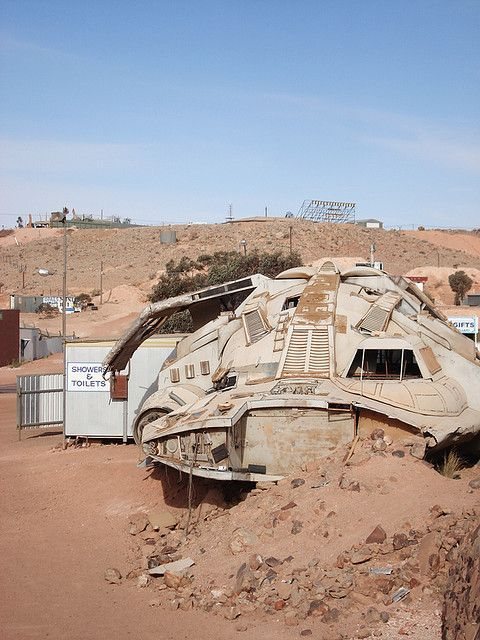 Cooper Pedy desert scene • strange building I thought maybe a prop from the movie filmed there, Mad Max but Belinda Gillmore has helped by telling me it is a prop from the film 'Pitch Black' South Australia • big things Australia tour