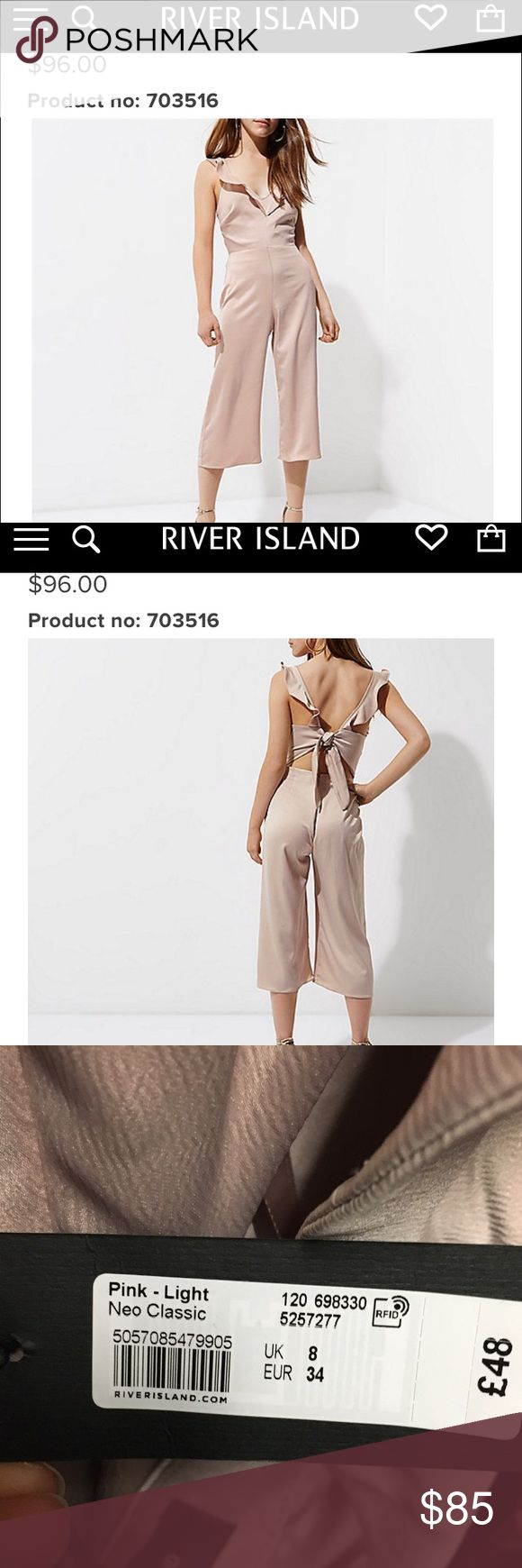 NWT River Island Pink Nude Jumpsuit! New with tags! Pinkish nude River Island Tie back Culotte Jumpsuit! SO cute! Bought it for a wedding and ended up wearing something else! US size 2 UK 8. Sold out online in this size. River Island Pants Jumpsuits & Rompers