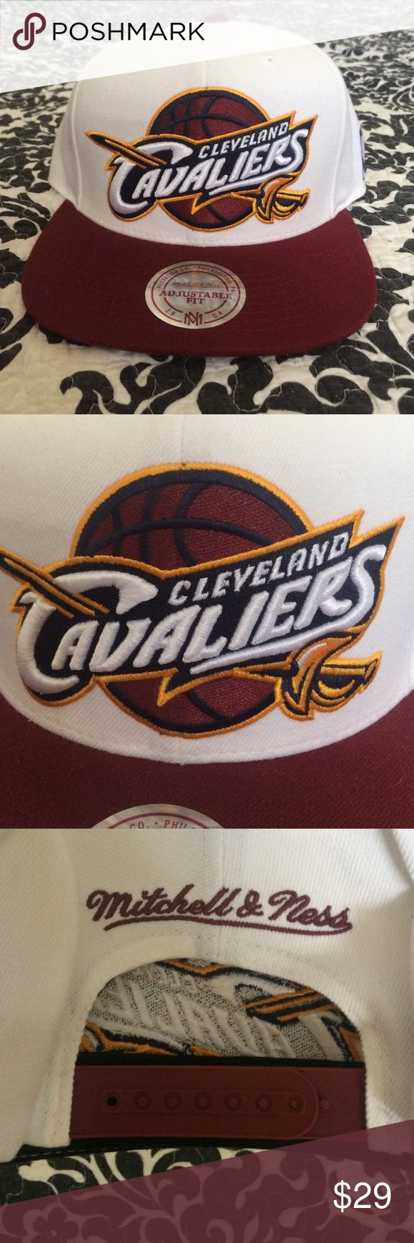 Cleveland Cavaliers SnapBack This Cleveland Cavaliers New Era NBA Cavs HM 9FIFTY Snapback Cap features an embroidered Cleveland Cavaliers logo at front, a stitched New Era® flag at wearer's left side and a snapback closure for an adjustable fit. Interior includes branded taping and a moisture absorbing sweatband.  Style:  20684621 Color: Navy Material: Made of 100% Polyester, Woven Departments:  Snapback,Adjustable,9FIFTY Crown:  High  Closure:  Snap  Fit:  Structured  Bill Type:  Normal…