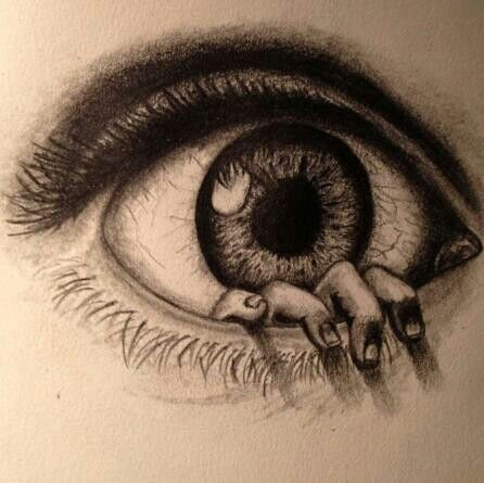 Incredibly drawn eye with a hand coming out of it.
