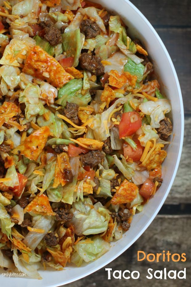 This Doritos Taco Salad is perfect for a potluck! Only 150 calories or 4 Weight Watchers SmartPoints per serving! www.emilybites.com