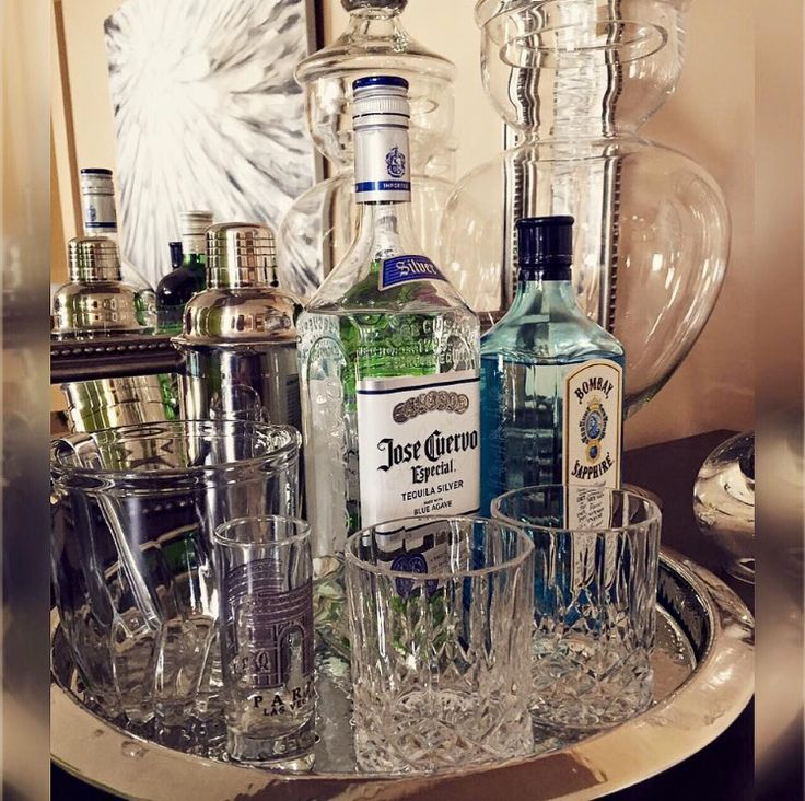 Love the look of heavy bottom crystal tumblers with the beautiful colors of hard liquor bottles. Set together in a beautiful tray with a few other accents #Style19