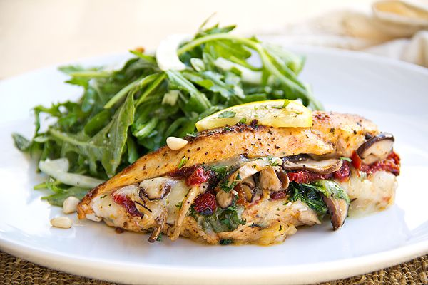 This looks BEYOND delicious!! Provolone, Spinach and Shiitake Mushroom Stuffed Chicken Breast with Shaved Fennel and Arugula Greens.
