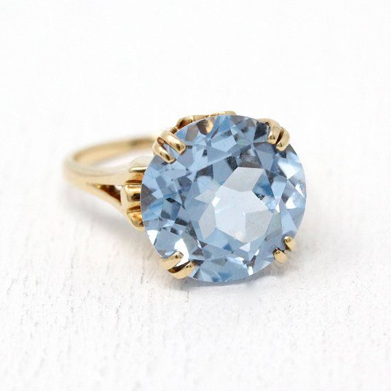 Dazzling Vintage 10k Rosy Yellow Gold Cocktail Ring Featuring A Large Created Light Blue Spinel The Pretty Retro Ring Yellow Gold Cocktail Ring Vintage Rings