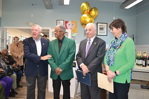 Pictured, from left, are Mayor Gee Williams, Jesse Turner, County Commissioner Bud Church and Historic District Commission Chair Carol Rose. Photo by Charlene Sharpe
