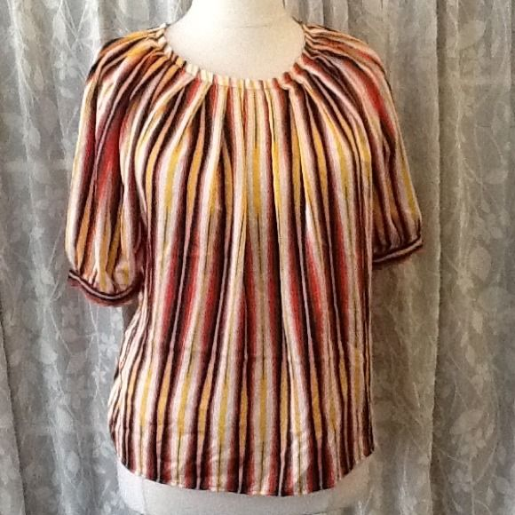 Sateen bright striped blouse Worthington sateen blouse, loose half sleeves, high pleated like collar. Loose fit can be cinched with a belt. Laying flat measures approx. 25 inches from shoulder to hem. 100% polyester. Would best fit a 14/16 Worthington Tops Blouses