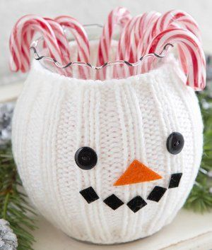 Who wouldn't want to grab a candy cane out of this adorable knitted snowman decoration?