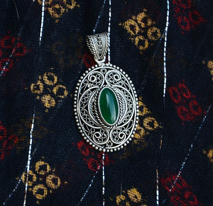 "Purchased in Istanbul, this Turkish Telkari pendant was handcrafted in Mardin. It is 1.75"" tall and .75"" wide and has a green stone embedded in it. It is the perfect addition to any wardrobe!"