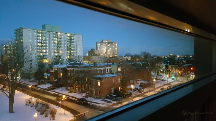 """A slice of downtown Ottawa"" - This is a mobile phone photo of downtown Ottawa east looking through an apartment window across from MacDonald Gardens park to the left of this scene here in the photo."