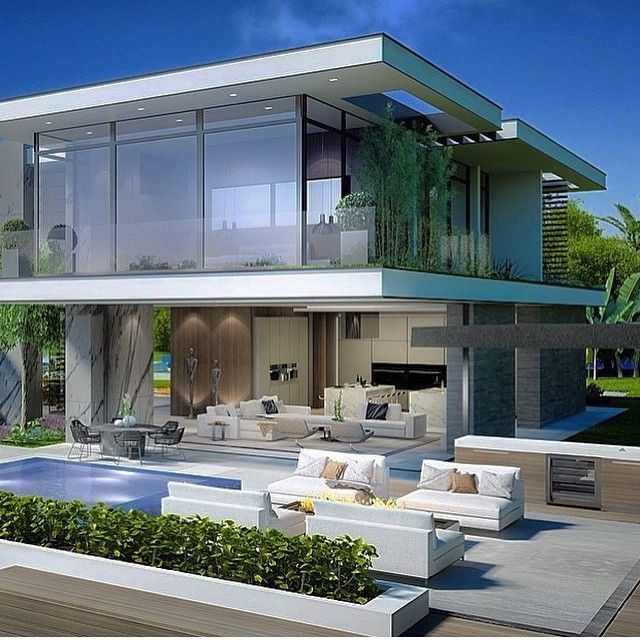 A white house with huge glass fronts and a pool in front of the house. Plenty all is in white only some stress in other colors to create some eye-catcher.