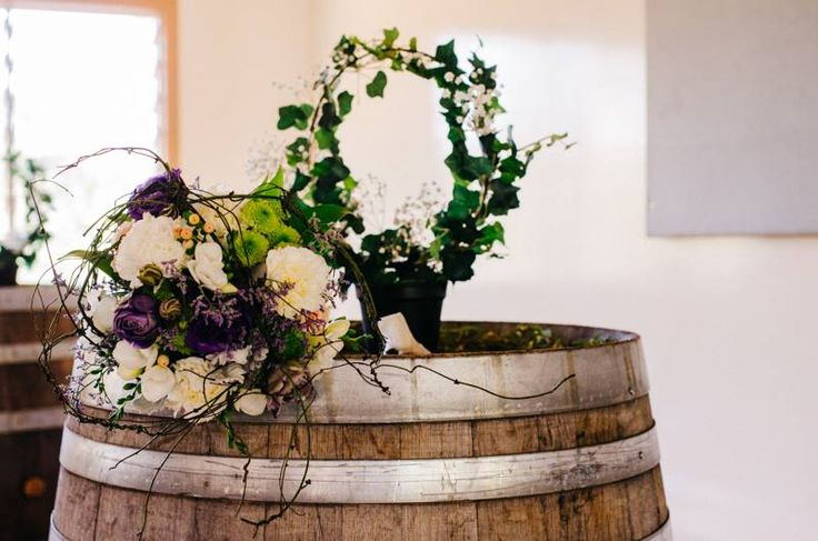 Simplicity with gorgeous flowers atop of the wine barrel.