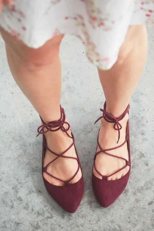 Maroon lace-up flats.