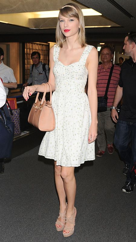 24 Reasons Why Taylor Swift Is a Street Style Pro - MAY 31, 2014 Swift arrived at Narita International Airport looking picture-perfect in a pretty floral print sundress, accessorizing it with an embellished braided headband, Red C Jewels, a Tod's handbag, and strappy nude heels.
