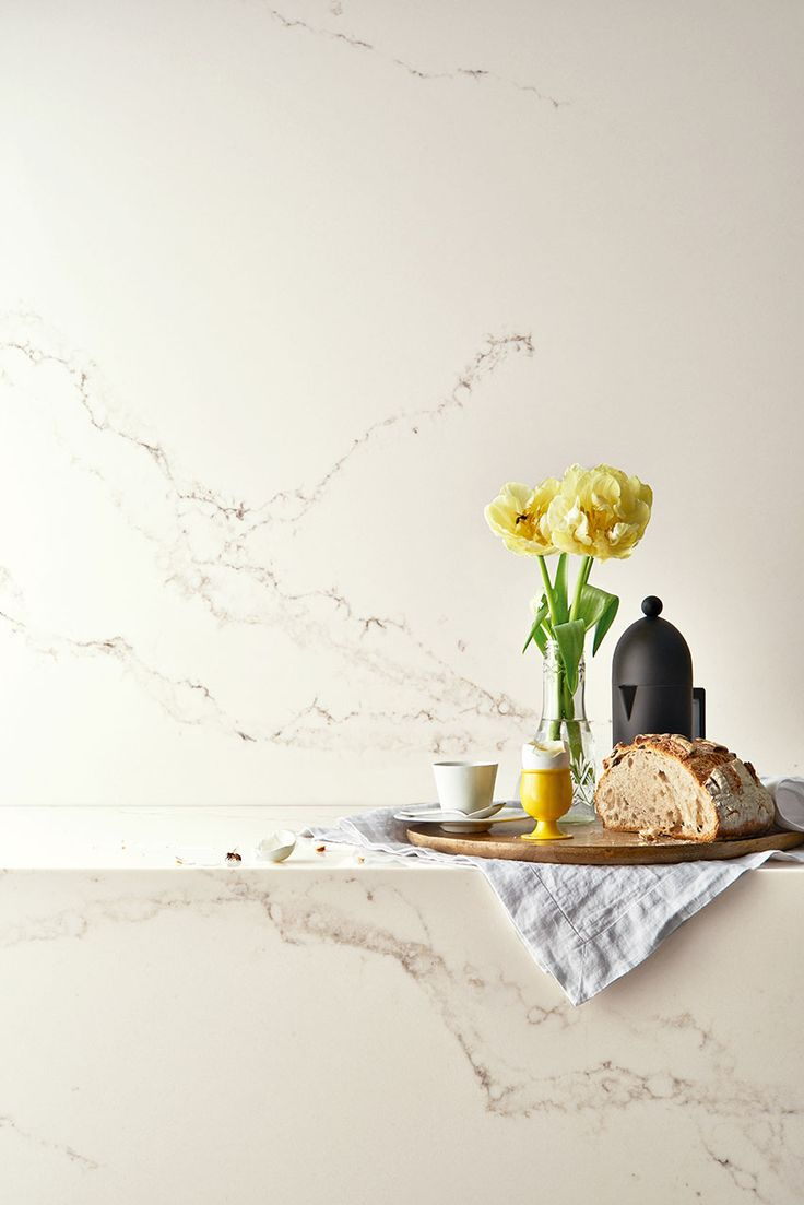 We love a clean and crisp kitchen and the Statuario Nuvo tile from Caesarstone is divine.