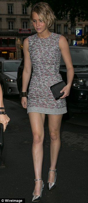 Final touches: Jennifer wore a pair of silver heels with a silver cuff around her wrist