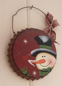 The Snowman--on an old tin-looks like a large bottle cap :)