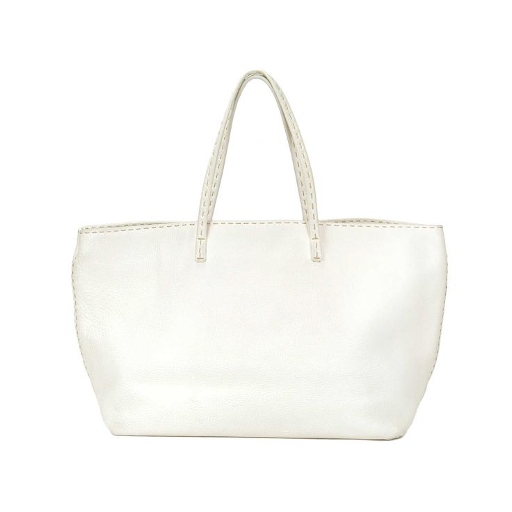 this hand crafted selleria shopper tote is in a creamy shade of white and features thin