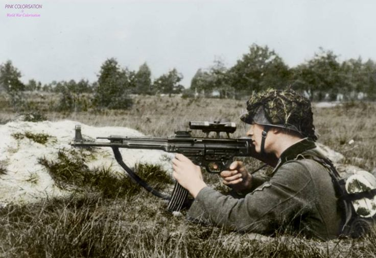 A soldier demonstrates the transitional MP 43/1 variant, used to determine the suitability of the rifle for sniping purposes, October 1943. The rifle is fitted with a ZF 4 telescopic sight.
