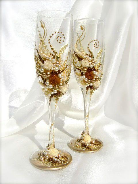 Wonderful Wedding champagne glasses, elegant toasting flutes in ivory, gold and brown, set of 2. $56.00, via Etsy.
