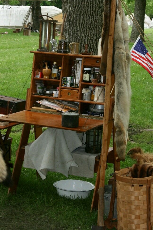 Camp kitchen. Buckskinners Fort Atkinson [These are the type of legs I can add to my chuck box!!! ]