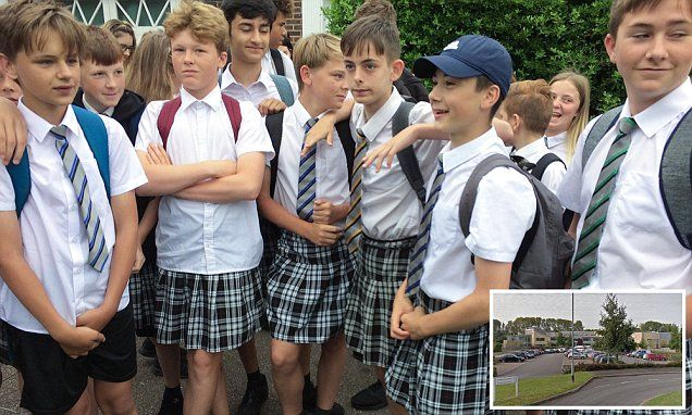 Teenage schoolboys turn up for class dressed in SKIRTS