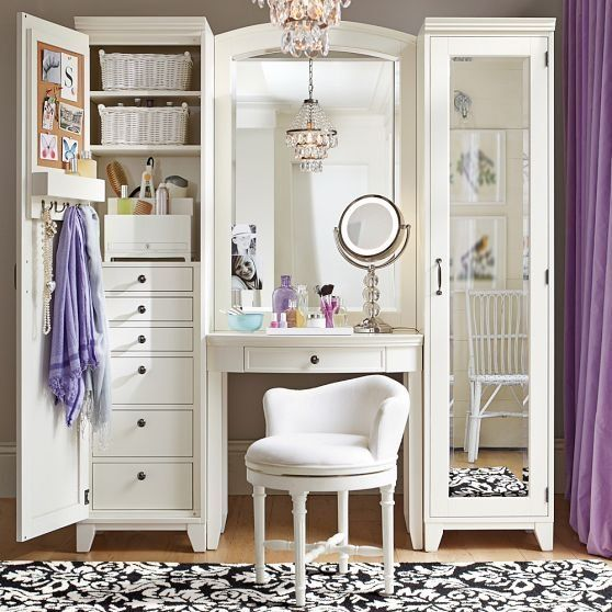 Vanity with custom mirrored cabinets...everything you could need in a girl space!!