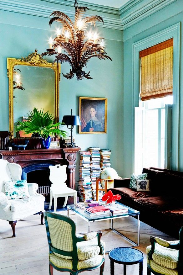 Insider Tips for Increasing Your Home's Functionality// blue walls, collected, chandelier, books, brown velvet sofa