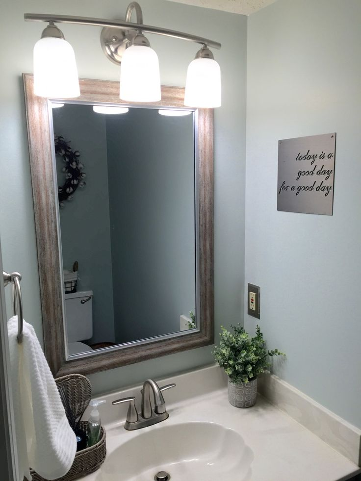 Farmhouse small half bath renovation. Fixer Upper bathroom in Sherwin Williams sea salt and dorian gray cabinets
