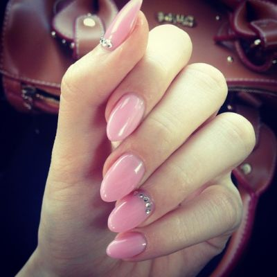 Long pointed nails that are slightly rounded are in for the new year. This look is very classy and can be worn by anyone. Try adding some jewels to a nail to add a little fun