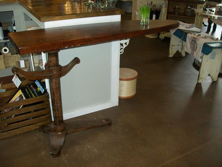 Antique industrial ironing board has a variety of uses around the home.