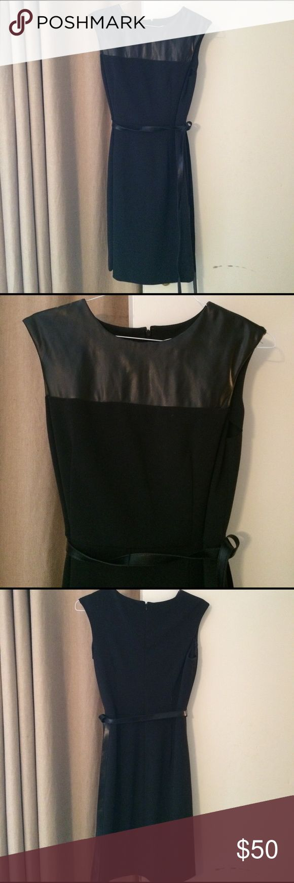 Black cocktail dress Calvin Klein black cocktail dress...faux leather top with faux leather belt that can be tied around waist. Worn once!! PRECIOUS!! Calvin Klein Dresses