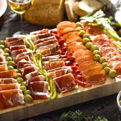 This is a great way to serve antipasto using cured meats, cheeses, olives, and more.