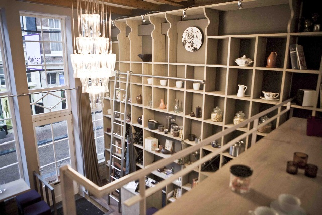 The bookshelf, lobby and chandelier at The Kitchen