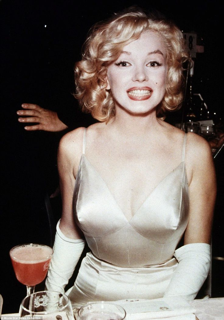 Some like it hot: Marilyn Monroe smiles broadly for the cameras as she enjoys a night out on the town   Read more: http://www.dailymail.co.uk/news/article-2305241/Marilyn-Monroe-Elizabeth-Taylor-Judy-Garland-captured-collection-3-million-photographs-showing-glamor-Old-Hollywood-offered-auction.html#ixzz2PvQyefK6  Follow us: @MailOnline on Twitter | DailyMail on Facebook