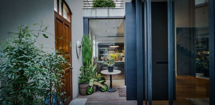 Architecture, Cool Stylish Creative Interior House Design Featuring Cool Interior Garden Potted Plant Wood Paneled Floor Round Table Door Mat And Glass Wall: Stylish Creative Interior Design Displayed by V House in Tel Aviv
