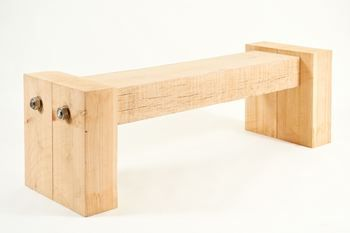 Product Description  This bench is very architectural in its design. It was conceived with the public realm in mind, as a piece of street furniture. The bench features an oak sleeper suspended in between two cedar end blocks by oversized, industrial stainless steel bolts.    This product is handmade to order and as such has a lead time of 3 weeks, but you will be advised on the delivery date when you place your order.    L 150cm W 46cm