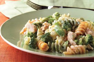 Cheesy Rotini and Tuna recipe - Why bother with a casserole when this low-cal, low-fat, big-flavor tuna-and-pasta dish can be yours in just minutes? You don't even have to turn the oven on.