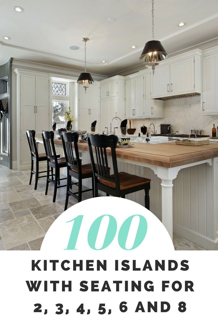 A Contemporary Kitchen With White Cabinets 4 Chairs In The Kitchen Kitchen Island With Seating Contemporary Kitchen Island Kitchen Island Designs With Seating