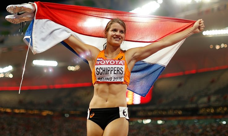 Dafne Schippers upgraded to gold in a breathtaking 200m final at the world championships in Beijing while Great Britain's Dina Asher-Smith finished out of the medals she broke the 30-year-old British record on her way to finishing fifth